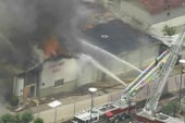 Firefighters battle 5-alarm fire at...