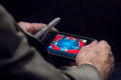 Sideshow: McCain plays poker on iPhone...