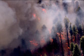 Historic wildfire being fought from ground...