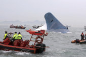 Search for missing after ferry capsizes