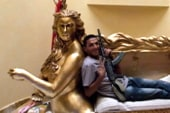 Rebels find Gadhafi's gold mermaid couch