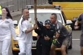 Olympic-sized swipe occurs during torch relay