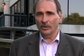 Axelrod jabs Romney over corporations