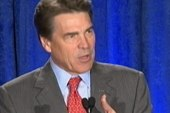 Rick Perry heckled on immigration