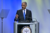 Holder questions 'Stand Your Ground' in...