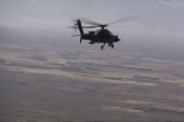 Helicopters raise troop risks in US 'air war'