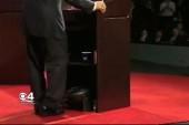 Fan flap flusters Scott while debate waits