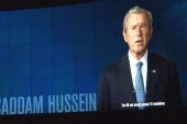 Bush spins Iraq decision in library exhibit