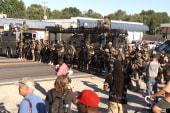 Sundown in Ferguson brings tear gas onslaught