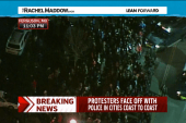 Arrests in Ferguson as police disperse crowds