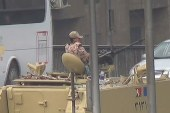 Streets of Cairo open with heavy military...