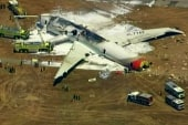 Crews douse flames on crashed Boeing 777...