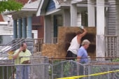 Crews board up Cleveland house of horrors