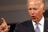 Obama defends Biden