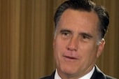 Romney defends business experience