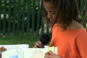 Obama girls read to kids at egg roll