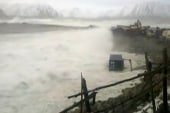 Huge storm waves slam remote Alaska
