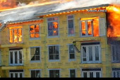 Fire engulfs complex; worker narrowly escapes
