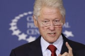 Clinton tries to 'reclaim populist ground'