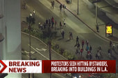 LA protesters take to the street in...