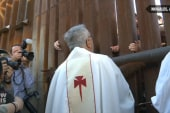 Divided families meet for mass at the border