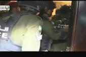 Police rush in to arrest teacher killing...