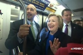 Just an average commuter: Clinton rides...