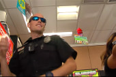 Police officer caught dancing on security cam