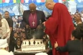 Bishop Tutu and Dalai Lama dance, party