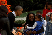 Barack and Michelle Obama greet trick-or...