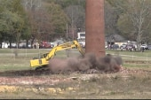 Demolition nearly crushes backhoe driver