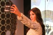 Kardashian wax figure takes a selfie