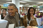 Obama jokes about looking 'sad' on book cover