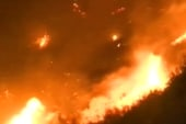 Major wildfire in Nev. threatens homes,...