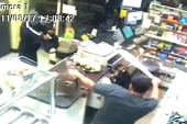 Caught on camera: Clerk foils robbery with...
