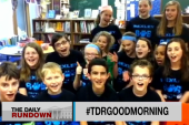 Fifth grade students say good morning to...