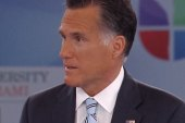 Romney attempts to distance himself from...