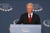 Clinton urges support for Obamacare