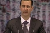 Assad showered with cheers, praise
