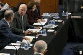 Key Senate panel approves crack down on...