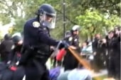 Pepper spray cop gets settlement