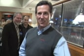 Santorum questions Obama's religious beliefs