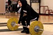 Muslim weightlifter spurs change to dress...
