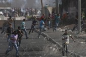 Palestinians, Israeli troops clash
