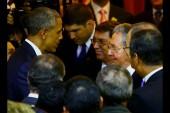 Obama and Castro shake hands