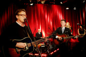 Joe and country star Lyle Lovett perform...