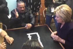 Hillary Clinton celebrates dominoes win in...
