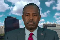 Ben Carson stands with Trump