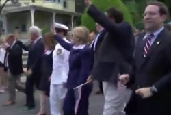 Clintons participate in Memorial Day parade