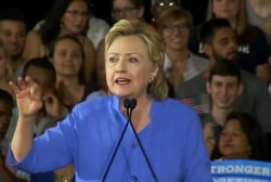 Clinton camp moves past investigation